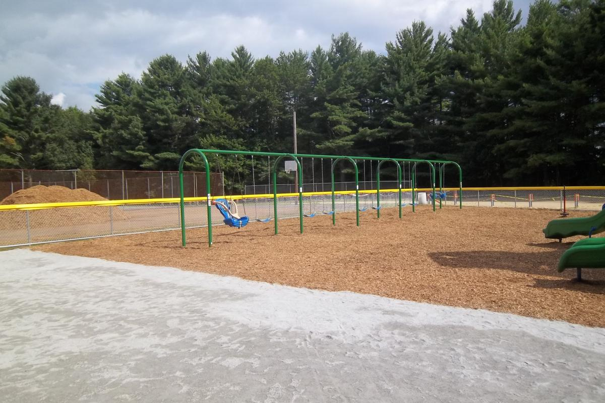Swing set with a handicap swing on the far left