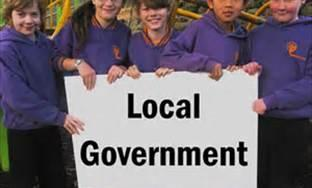 Kids Holding Sign saying local government